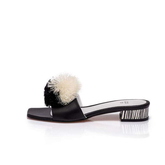 Not just black or white...  M A D O Charming slide sandals black + white nappa leather black + white snake skin black and white pompoms City + resort perfection  #1821 #2021 #freedom #celebration #greeksummer #boudoir charm  #madosandals inspired by beautiful #Greek heroine  #madomavrogenous born in #trieste lived in #mykonos and #paros #cyclades #raniakroupishoes #raniakroupiluxuryshoes #femakeempowerment