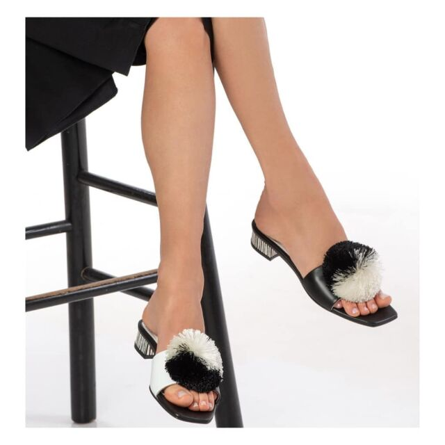 M A D O  playful pompons slide sandals  #madomavrogenous greek  #heroine inspiration for  #madosandals #1821 #1821_2021 #celebration #pompoms #tsarouhi #blackandwhite #biancoenero new atelier #Kolonaki #Hrakleitou 16 #raniakroupishoes #raniakroupiluxuryshoes